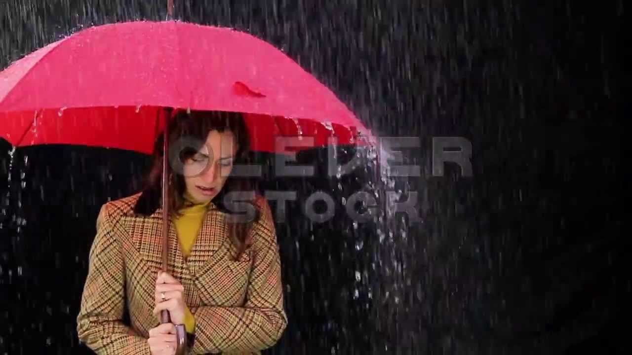 Worried Woman in the rain holding umbrella Bad weather ...