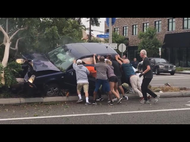 20 People Help Flip SUV to Free Those Trapped Inside