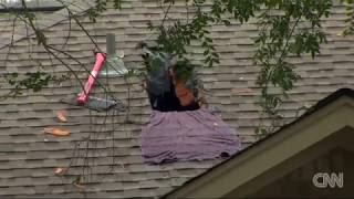 Homeowner cut hole in roof to escape Texas floods