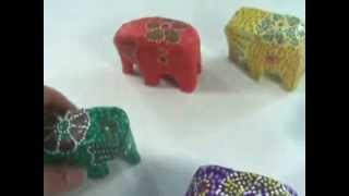 handcarved wood animal handmade in Bali miniature elephants set WholesaleSarong.com