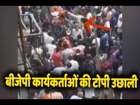 सूरत में कल पीएम मोदी की रैली से पहले बीजेपी कार्यकर्ताओं की उछाली गई टोपी