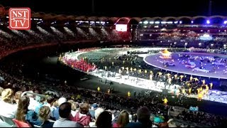 Didgeridoo, downpours as Games opening ceremony starts