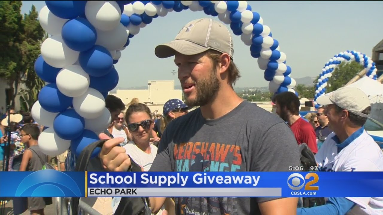 clayton-kershaw-uses-his-valuable-arms-to-hand-out-backpacks-to-kids-in-need