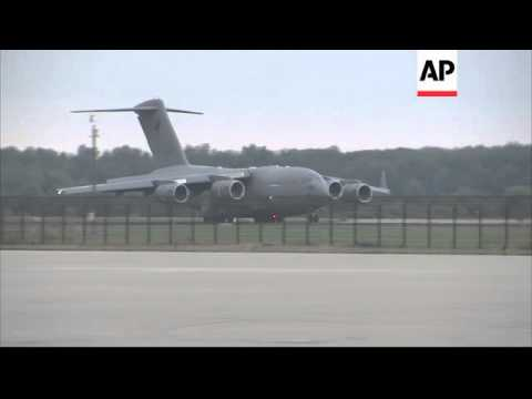 Planes carrying victims of the Malaysian plane crash arrive in Netherlands