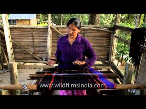 A Lotha Naga woman weaving on loin loom
