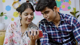 Indian couple watching a video on their smartphone and laughing loud
