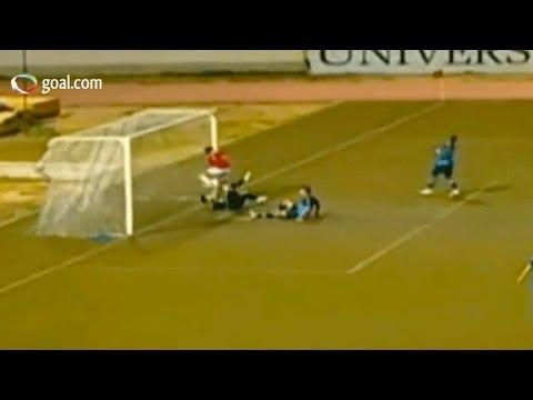 A footballer runs into the post after scoring