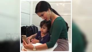 Video hot sunny leone plays, takes selfie with kid