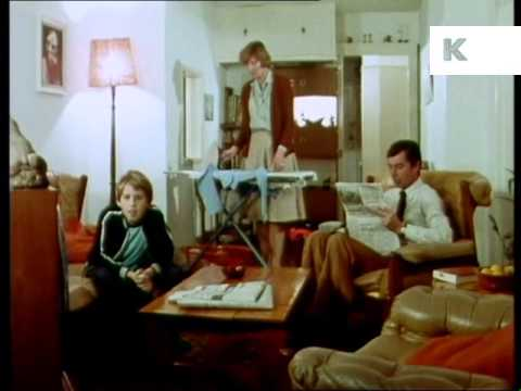 1970s uk family in living room watching tv television for V a dundee living room
