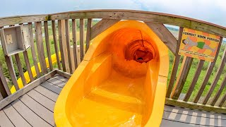 Yellow Tasmanian Twister Water Slide at Raging Waves Yorkville