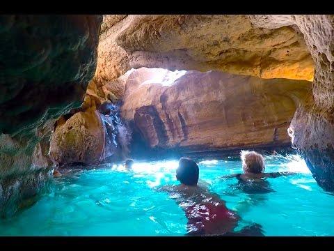 Swimming in Wadi Ash Shab pools, Oman