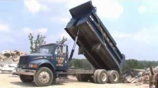 International Dump Truck Dumping Asphalt