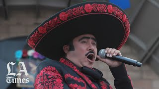 Mariachis ask Santa Cecilia, the patron saint of musicians, for her blessing