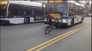 WTF - Guy Does Bicycle Wheelie In Incoming Traffic In NYC HD