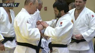 'I'm not a girl, I won't cry': Putin jokes about judo 'injury' after training in Sochi