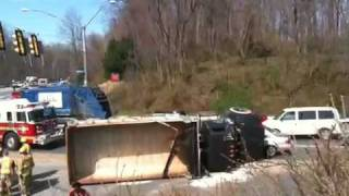 Dump truck flips over near Fairfax video studio