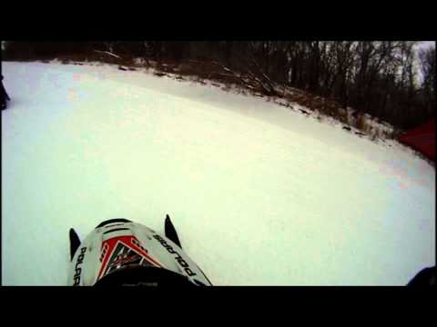 Snowmobiling on the Red River, Manitoba.