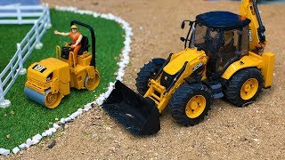 Bruder Construction Toys JCB Backhoe Tractor Excavator and Drum Compactor in action!