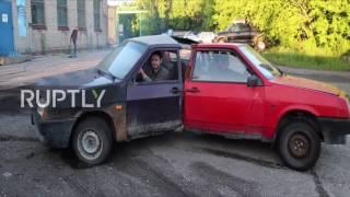 let it spin automotive fidget spinner burns rubber in novosibirsk