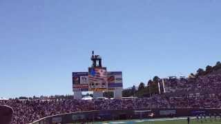 f22 f15 in formation flyby over the stadium