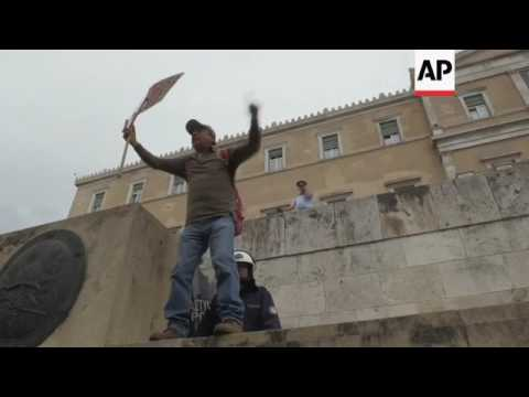 Protesters fire flares at riot police in Athens