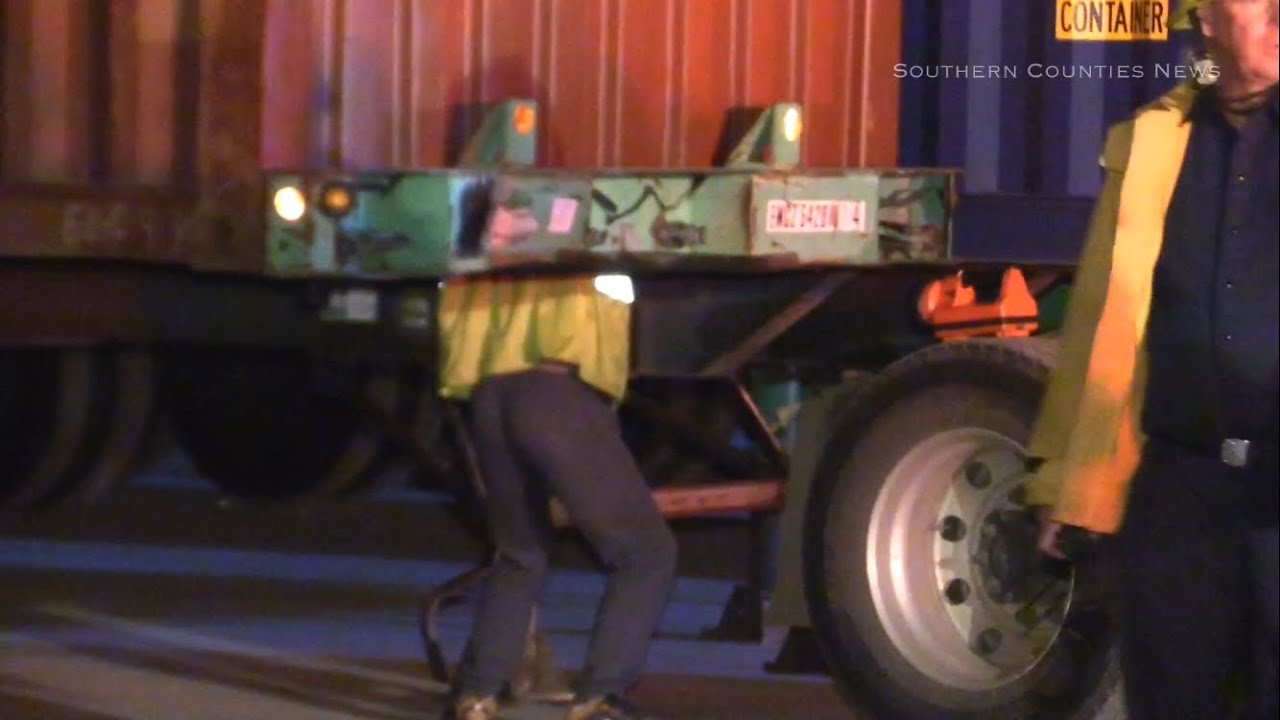 man crushed to death between shipping containers
