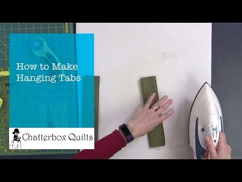 Learn to Make Hanging Tabs for Your Wall Hangings