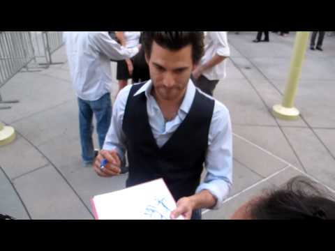 Johnny Whitworth greets  at the premiere of