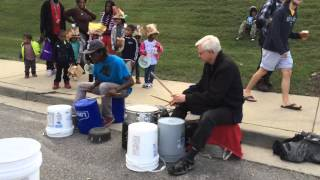 Ray Breakall plays with the street drummer at the 2015 Richmond Fol...