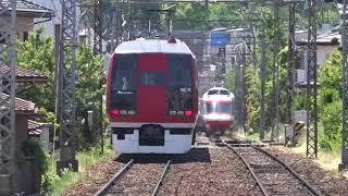 真夏日の中、「スノーモンキー」と「ゆけむり~のんびり号~」の離合、長野電鉄。