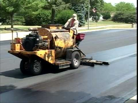 sealmaster sealcoating liquid road asphalt pavement sealer on parking lot