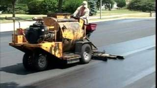 SealMaster Sealcoating: Liquid Road Asphalt Pavement Sealer on Parking Lot