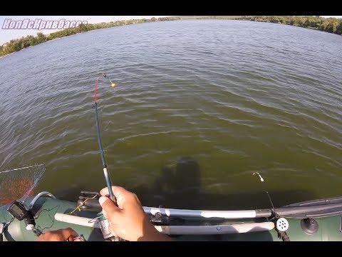 Рыбалка с лодки на кормушку и мормышку.