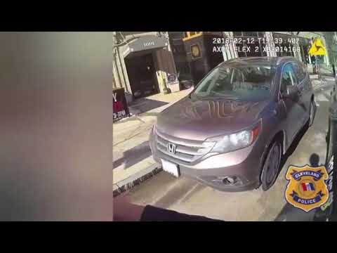 Watch Cleveland cop with parking tickets drive away from fellow officer