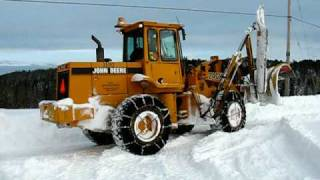 Frontend Loader Plowing Snow