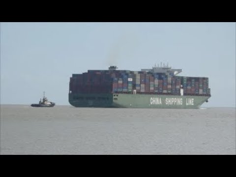 Heavily laden CSCL Mars departs Felixstowe's deep water berth 8 with assistance of two tugs.  18th S