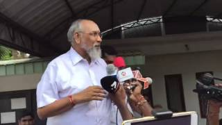 Northern Province Chief Minister Wigneswaran greets crowds outside his home