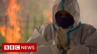 Delhi sees deadliest month amid raging pandemic - BBC News