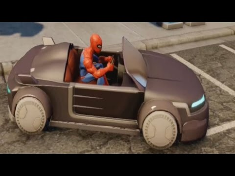 Spiderman is riding on a black car