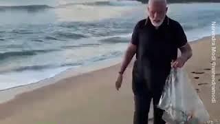 Indian PM Modi plogging at the beach