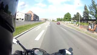 Scooter rider hits breaks window (road rage)