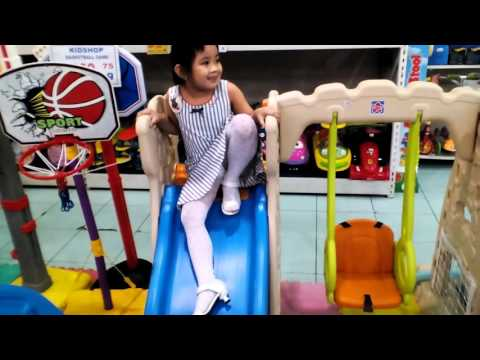 Kids At Play: Slide And Swing At Toys
