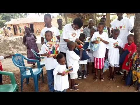 Radio Diamond Afrika Project representative with orphan children in Ghana