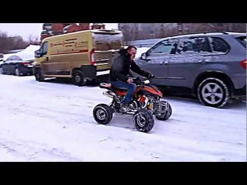 Детский квадроцикл Sym Fuxin Wolf 50 в снегу