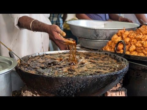 Hands in boiling oil indian chef fries fish with bare for Best oil for frying fish