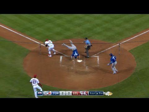 Coghlan scores by jumping over Yadi