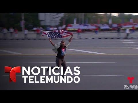 Atacan a hombre que irrumpe con bandera de EEUU en marcha en La Habana | Noticias | Noticias Telemu