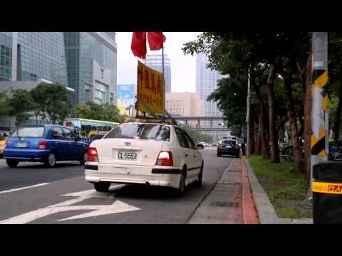 Chinese propaganda car of Xinyi patrolling around Taipei 101