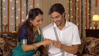 Newly married couple happily celebrating their first Diwali - festival of lights. Gift and Hugs