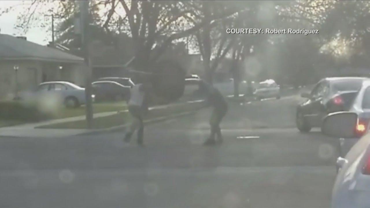 2 Men Brawl in The Street